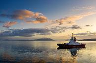 Tugboat waiting to escort a tanker ship