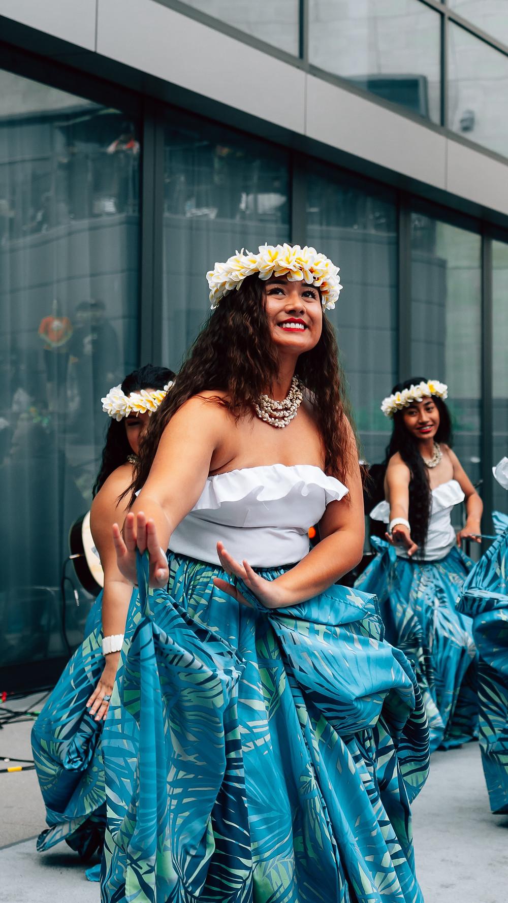 A Hawaiian woman dancing the hula
