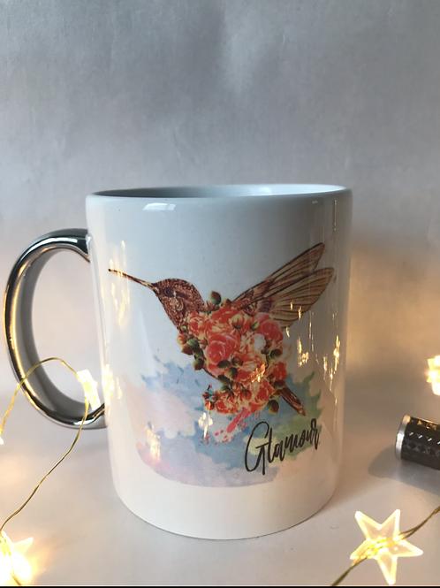 Silver handled hummingbird mug