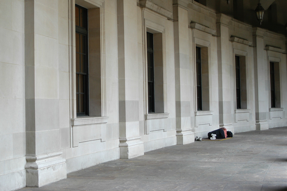 A homeless person sleeping rough in the city.