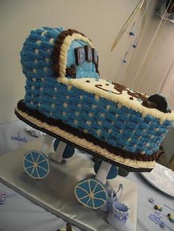 Blue and white bassinet cake