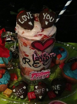 Facebook - That's a beer mug full of cake, and strawberries