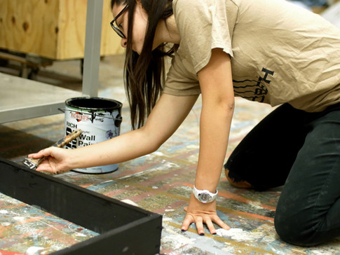 Painting a frame.
