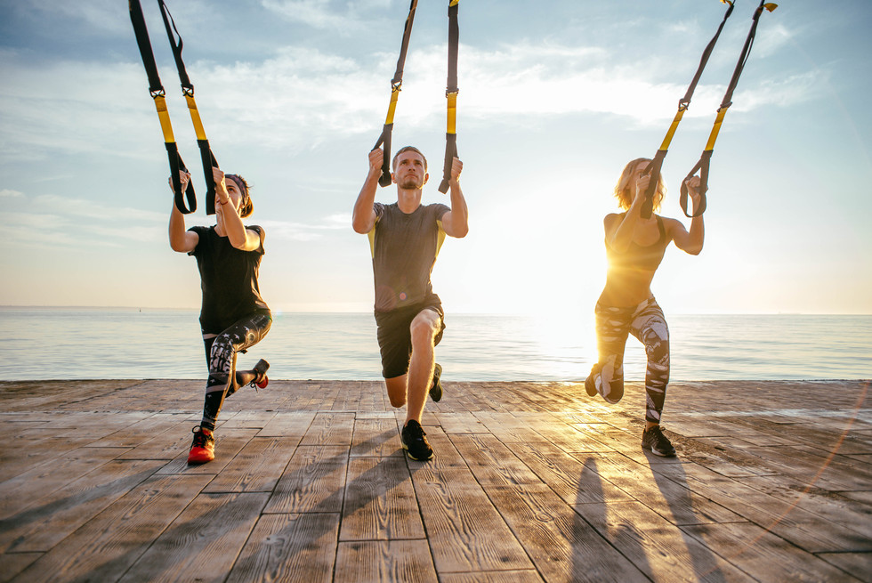 Incorporating TRX suspension trainers into our circuits to build total body strength