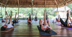 Morning yoga stretches in the outdoor pavillion