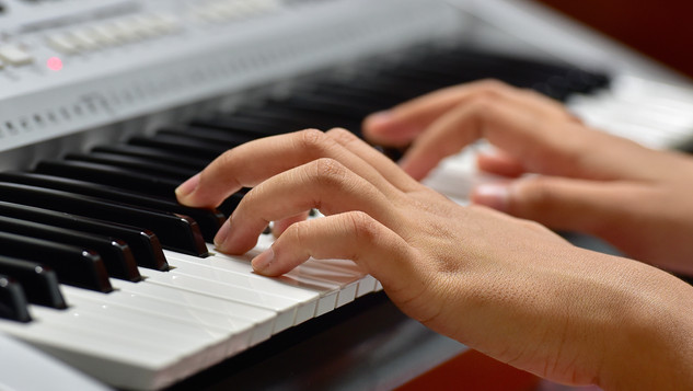 Close up of the hands of a girl playing