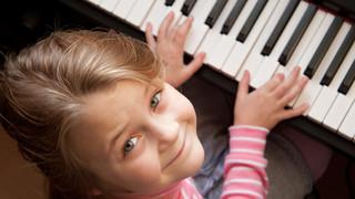Young girl sitiing at digital  piano.jpg