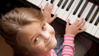 Young girl sitiing at digital  piano.jpg