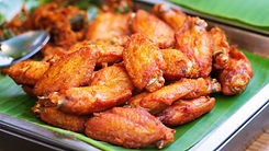 close-up-of-fried-chicken-wings-thai-str