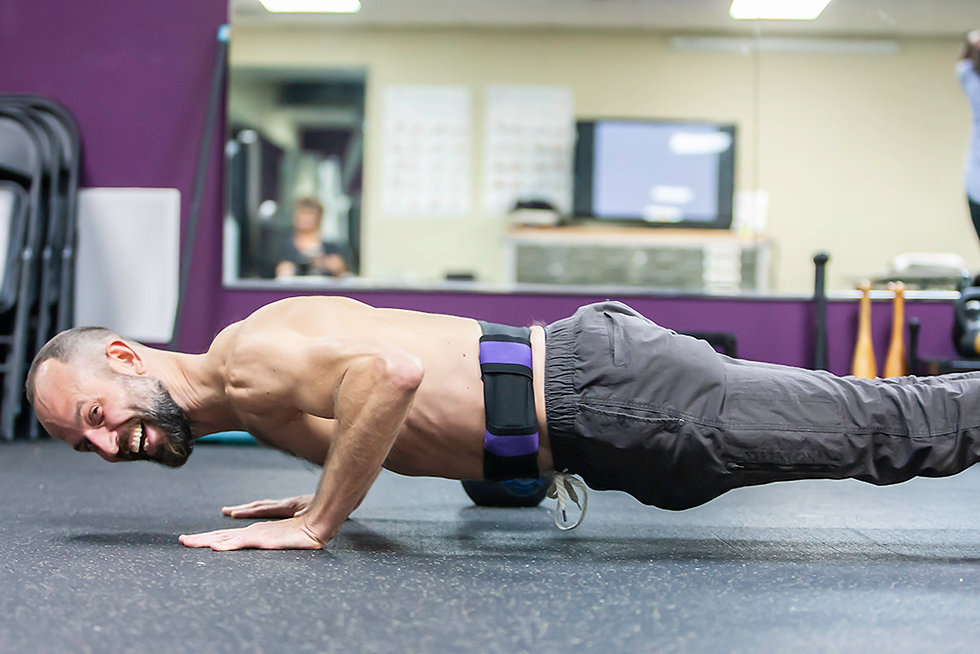 Michael Ballentine, the owner, doing a pushup and smiling at the camera.