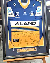 YOUR CHANCE TO BID ON A SIGNED AND FRAMED PARRAMATTA EELS NRL JERSEY, IN OUR FIRST SILENT AUCTION
