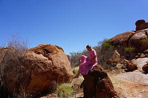 sitting on a rock.JPG