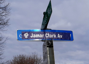 """Street Sign Defaced & Proclaimed """"Jamar Clark Avenue"""" by Protesters in Minneapolis"""