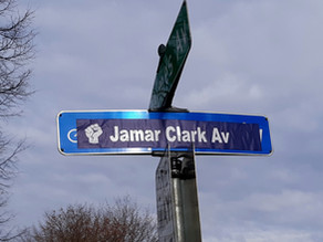 "Street Sign Defaced & Proclaimed ""Jamar Clark Avenue"" by Protesters in Minneapolis"