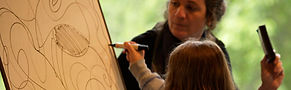 Nancy Katz facilitating art workshop with young child easel