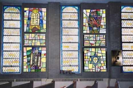 Installation of moved stained glass windows in light boxes with original windows with natural lighting.