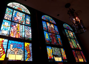 Completed installation of original stained glass windows in new location