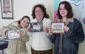 mother & children proudly show the mizrachs which they created at Temple Israel in Greenfield, Massachusetts