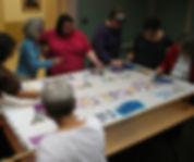 women rabbis painting silk healing scarves, including Sally Priesand