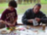 boy & father using art materials