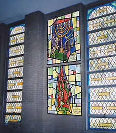 Concept for installation of stained glass windows along side existing windows.
