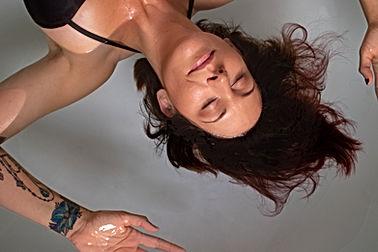 A lady enjoying a blissful floatation session