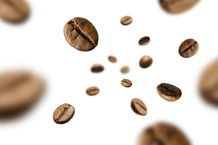 Brown roasted coffee beans falling and f
