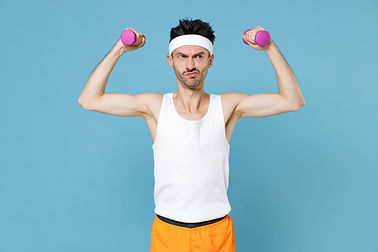 Confused young strong sporty fitness man