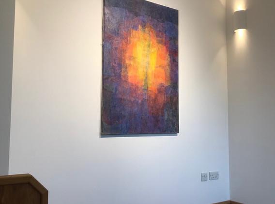 6 Béranger artwork lit by spotlight and