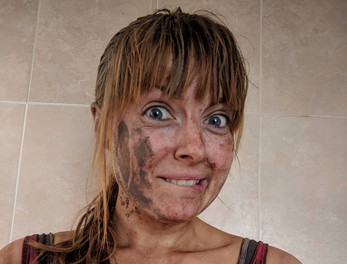 Clare after a muddy obstacle course
