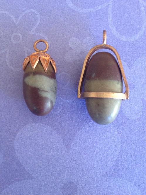 Colgantes y anillos de Shiva Lingam