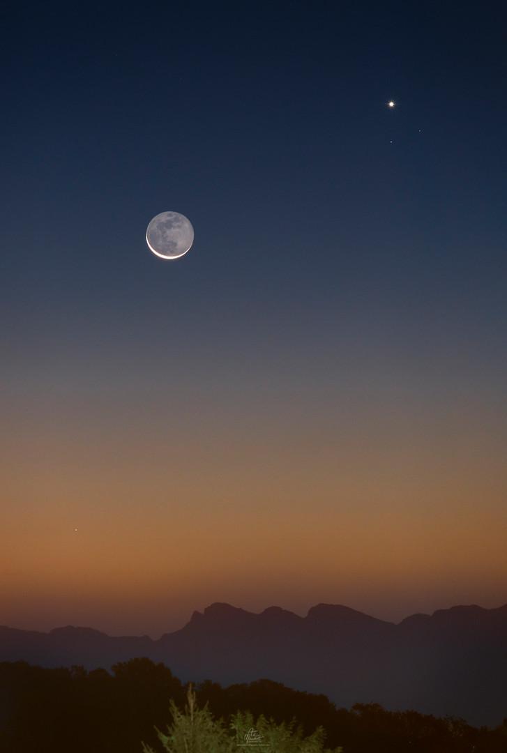 Venus, crescent moon over the Alps
