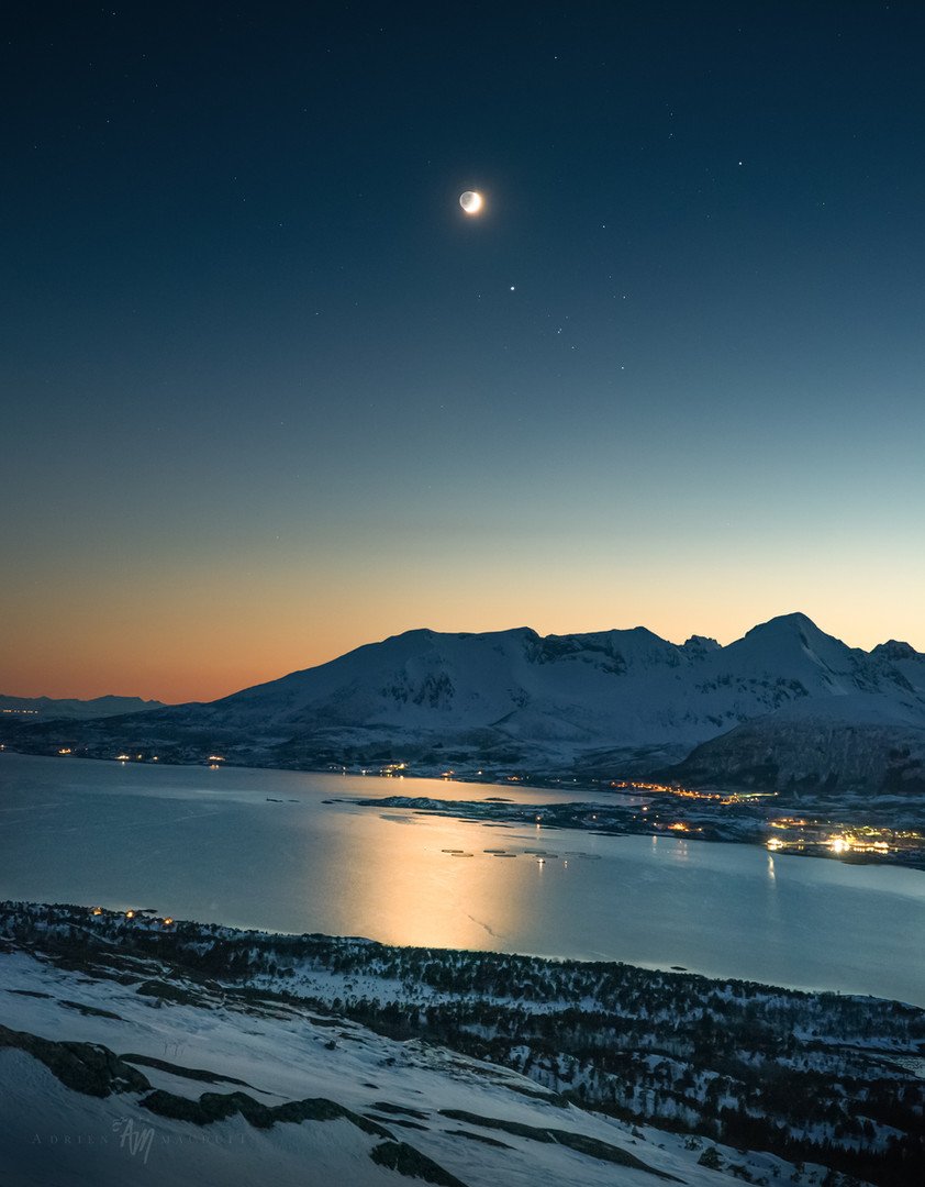 Cresecent moon over Arctic landscape