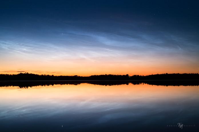 Noctilucent clouds reflections