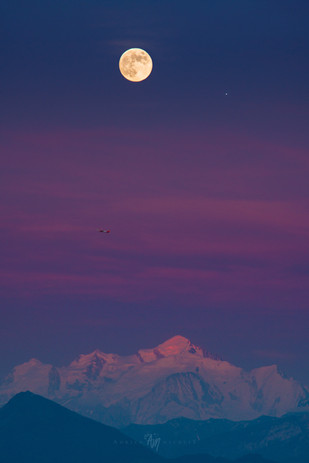 Strawberry moon, plane, Jupiter at Sunset