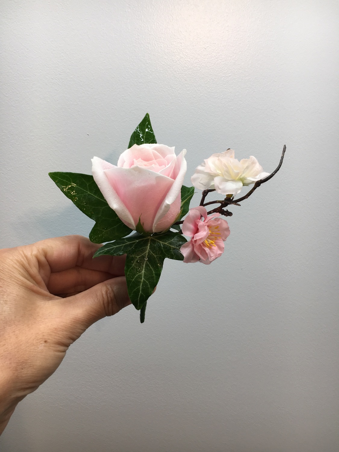 Blush rose with blossom buttonhole