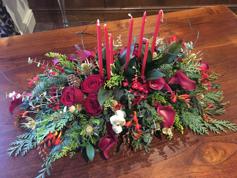 Red and gold table centre wth candles