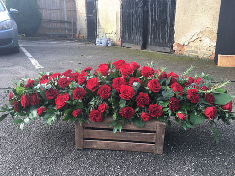 Red rose and carnation coffin spray