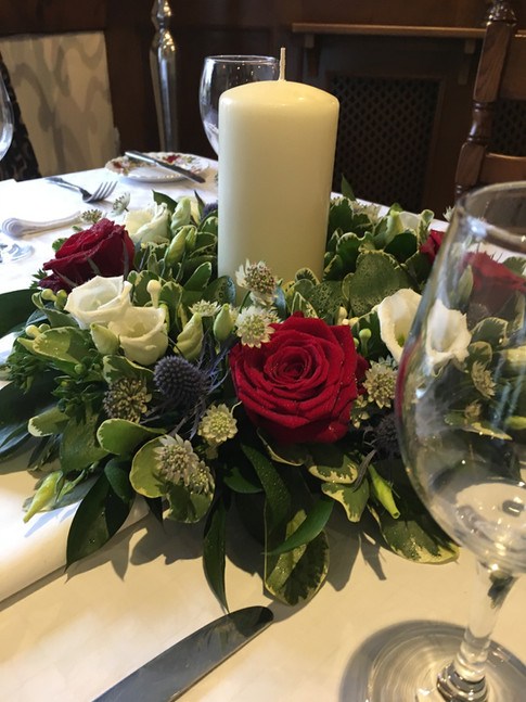 Red, white and blue table centre with candle