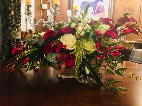Aysemetric floral table arrangement