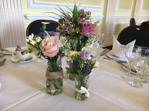 Wedding flowers filled jam jars