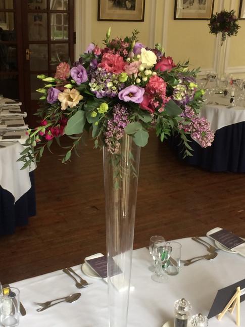 Wedding flowers Tall vase table centre