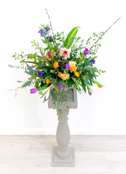 Seasonal flowers pedestal arrangement