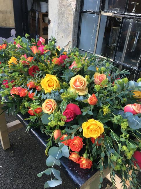 Mixed rose coffin spray