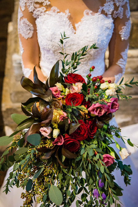 Wedding flowers Rich and warm coloured wild hand tied bouquet