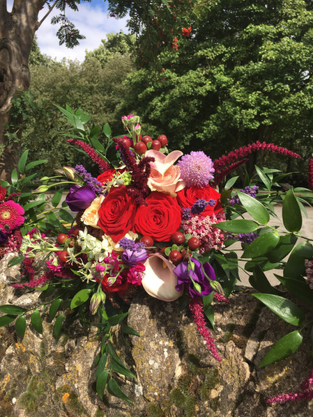 Wedding Flowers Red and Purple Bridesmaid bouquet