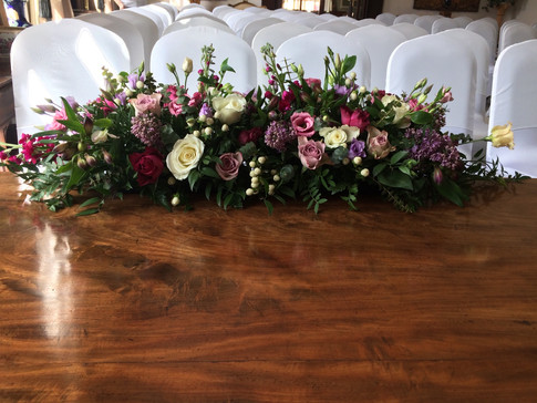Wedding flowers Ceremony table long and