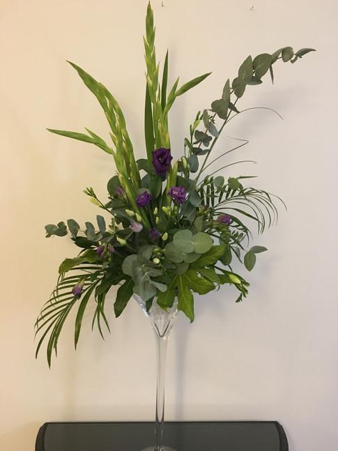 Tall purple flower arrangement