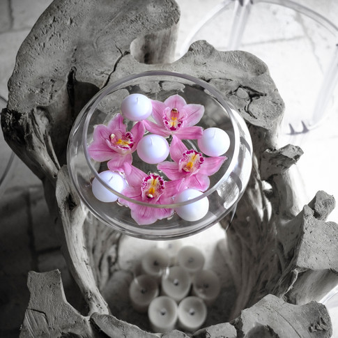 Floating candle and orchid table centre