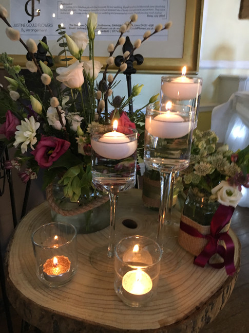 Wedding flowers Floating candle wedding table centre